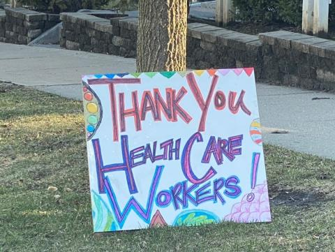A sign reads 'Thank you HealthCare Workers!'